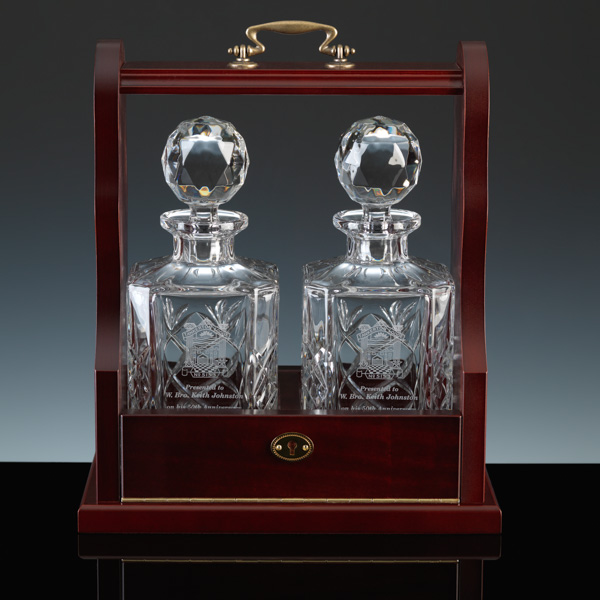 A Tantalus. Cut crystal decanters for engraving.