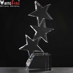 Three crystal Stars mounted on block of crystal. Star Award.